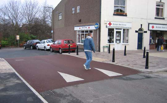 picture of a man walking across an informal crossing??