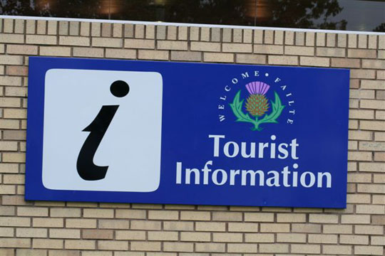 photograph of a tourist information symbol with text