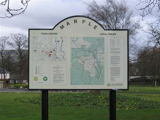 photograph of a town centre and local area sign post with map
